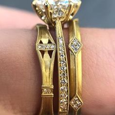 Today's #saturdaystack is an ornate trio of @erikakwinters! That means it's an elegant masterpiece from all angles, with those milgrain details and her signature brushed finish. The Laurel engagement ring tapers ever so smoothly, and is shown here cosied up between the Helena and Lily bands. Visit us today to get in on this stack action, and try on the new arrivals from Erika Winters! #gstinspiredjewels All Angles, Band Engagement Ring, Try On, Diamond Bands, Meant To Be, Bling, Jewels, This Or That Questions, Elegant