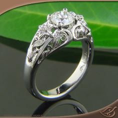 Vintage Ring ... love the lilies! This site has tons of unique engagement rings!