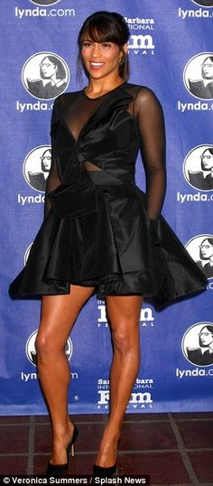 Paula Patton has great legs in an awkward looking black mini-dress with sheer back and sleeve detail from Anthony L. Williams #legs #heels #lbd