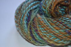 This beautiful yarn is hand spun and dyed using cheviot wool. It is a two-ply, Aran weight yarn that is perfect for a variety of projects.