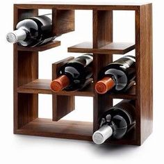 The design of this wine rack is both unusual and interesting. The shape of the wine rack is simplistic and the finish of the wood creates a contemporary feel to the design. The wine rack creatively holds the wine and presents them in an exciting way. Wine In The Woods, Eco Design, Design Creation, Wine Bottle Holders, Wine Bottles, Wine Cabinets, Italian Wine, In Vino Veritas, Wine And Beer