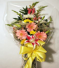 This Assortment of Mixed Fresh Flowers, Fuji Mums, Stargazer Lilies, Gerbera Daisies and Other Beautiful Flowers are perfect to Congradulate your recent Graduate