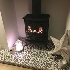 This tiles hearth is stunning! I love how stylish and eye catching it is. If you're looking to create something similar and have precise measurements get in touch and we can advise what will work well for you: https://www.stovefitterswarehouse.co.uk
