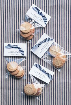 Brides.com: . For a seaside wedding, anchor-stamped shortbread cookies are thematically on point. Tie with a nautical striped ribbon to drive your theme home.