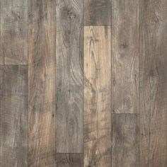 """Mannington Sobella Fiberglass Flooring  Sobella Prime glue/loose lay  Color:  Havana/Tobacco.  6"""" distressed oak pattern, Havana features the look of reclaimed wood.  I'm not a fan of one material trying to look like another, but this looks great.  Loose lay or glue down."""