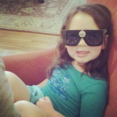 Juliet is wearing her passover glasses and is looking like one hip little nugget.