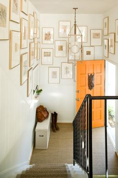 crazy orange door, crazy scary knocker, gloss white paint, and gallery of gold frames can make an IKEA storage bench look soooo good Home Interior, Interior And Exterior, Interior Design, Orange Front Doors, Wall Design, House Design, Door Design, Design Design, Tall Ceilings
