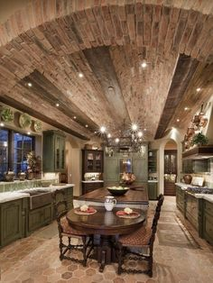 Love the ceiling; think I would carry over the brick into the floor and lighten up the cabinetry.