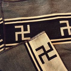 Woven Navajo rugs with 'Swastikas'.