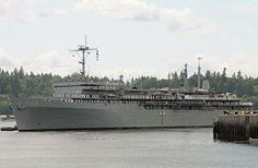 The submarine tender USS Emory S. Land (AS 39) pulls away from the pier at Naval base Kitsap-Bremerton, Wash.