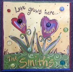 Love Grows Here is a wonderful saying to display in your garden or by your front door! If you want more heart flowers added, no problem. Just put that