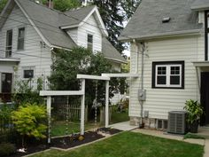 Rain Chain Aqueduct for gutter downspout, Aqueduct for water from roof.  Passes over the sidewalk and down the rain chain, Aqueduct to bring...