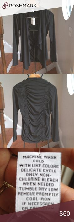 Carmen open cardigan Classic black cardigan will go with everything. Cute back detail. Open front. Carmen Sweaters Cardigans