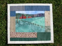 Small hand applique and hand quilted wall hanging.  Made by Daisychain Quilter.