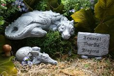 Mother & Baby Dragon For Your Fairy Gardens Outdoor Garden Art   ☀ This listing is for the beautiful Mother Dragon AND her Baby Hatchling - the sign is listed separately. ☀ Momma Dragon is an impressive 8.5 Long x 9 Wide x 2.5 Tall and weighs almost 6 pounds before packaging  ☀ Baby Dragon is 4.5 Long 1.25 Tall. Poor little guy is taking a rest before he comes all the way out of his egg and into the world  ☀ Handcrafted with my own special blend of cement & strengthening components resulting…