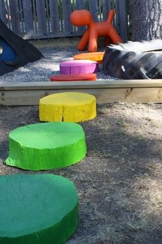 "rainbow colored stepping ""stones"" for our homemade playground"
