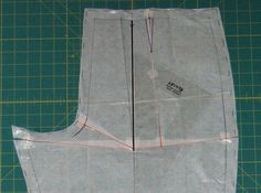 "7. Even out the crotch curve and side seam. Re draw the legs of the dart from the top to where the seam lines now meet. Extend the grainline of the lower piece to the top edge - the original grain line on the upper piece no longer applies. [ If your pattern had no dart then add the 1/4"" you have removed from the top edge to the side seam, tapering to nothing about 4"" down.]   This adjustment removes the equivalent of a fish eye dart from below the buttocks, shortens and narrows the dart and…"