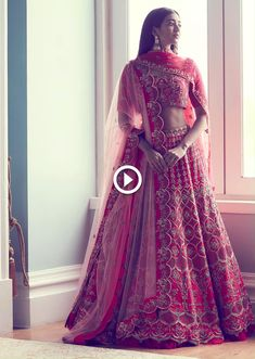Let the opulent shades of red bring the celebratory bride in you. The opulent red lehengas of this luxury bridal collection flaunt versatility, effortlessly translating looks for your day or night wedding & occasions. Pink Bridal Lehenga, Designer Bridal Lehenga, Indian Bridal Lehenga, Indian Bridal Outfits, Pakistani Bridal Dresses, Bridal Wedding Dresses, Indian Dresses, Indian Clothes, Wedding Lehenga Designs