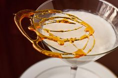 White Chocolate Creme Brûlée Martini (3 ounces vanilla vodka 1 1/2 ounces white chocolate liqueur 1/2 ounce butterscotch schnapps 1/2 ounce heavy cream)