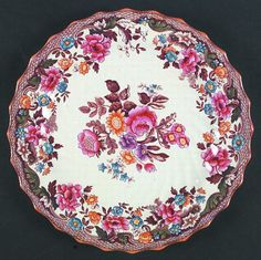 Copeland England. Spode British Flowers Dinner Plate. I have this and found out it is worth a lil bit of money.  I am thinking of selling it and someone can use it to replace or add their dishes or use as a display or dessert plate even though it is a dinner plate.  It is beautiful and I almost hate to part with it.