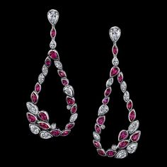 ​ Robert Procop. De La Vie Collection.  As gentle raindrops float through the air, giving life and color to the earth below, so do the tear shape gemstones give a world of color and exuberance to the magnificent focal points they surround.  ​This collection radiates brilliance and excitement with an array of colors and shapes. A bezel setting allows the gems to become the kaleidoscopic centerpiece.