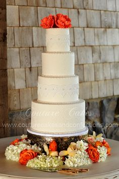 We made this beautiful wedding cake using vintage lace and pearls created from sugar for Cody & Bryan's wedding at DeBarge Vineyards, LaFayette, GA. The couple loved their cake and so did their guests.  The best part is the bride was Celiac and the entire cake was gluten free, non-gmo and organic. We had so much fun working with this wonderful couple!