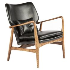 Showcasing faux leather upholstery and an ash wood frame, this midcentury-inspired arm chair is a stylish addition to your living room or den seating group.