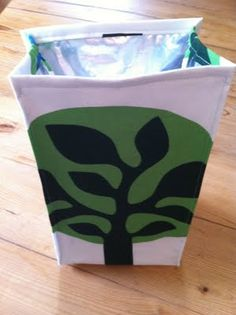 Make your own insulated lunch bag...uses a thermal bag from the grocery store as lining.