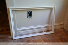 Picture frame moulding ready to be attached to wall - How to install picture frame moulding wainscoting - addicted2decorating.com