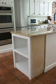 Microwave Shelf - the kitchen island was lengthened and a shelf was added to make room for the microwave. This is a brilliant use of space - via Driven by Decor