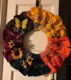 """This is the 12"""" Fall bandana wreath with flowers an a butterfly"""