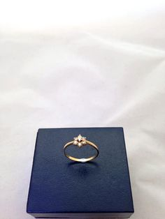 A dainty 18ct Gold Diamond Daisy Cluster Ring by IshyAntiques, £86.00