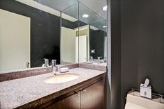 Powder Room has designer paint, granite counter top, undermount sink with single lever faucet. Under cabinet storage.