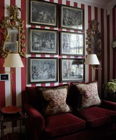 Red and cream striped walls, lamps, artwork, gilt mirrors - Paolo Moschino for Nicholas Haslam