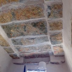 a wonderful roof made from stone with traces from the old colors