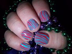 Sassy Zebra!!! I love it!!! They are a very colorful design! http://lorirarmstrong.jamberrynails.net/