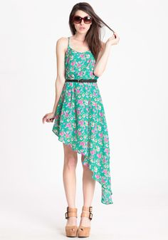 Live Free Floral Dress... super adorable with the asymmetrical hem. and love green! makes me want to sit in a garden somewhere...