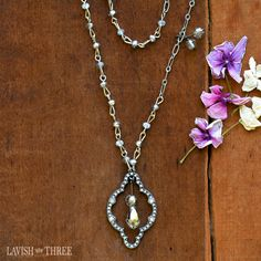 One of a kind ~ A host of smoky quartz-like and platinum crystals add a touch of elegance to our industrial silver necklace. A smoky crystal teardrop is encased in a vintage drop adorned with crystal gems.