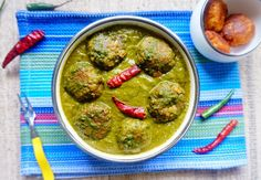 Palak Kofta is a classic famous north Indian curry dish. Koftas are delicious soft cottage cheese dumplings simmered in green spinach