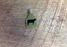 Small green and silver crackle ear tag pendant with blue sparkles and black cow silhouette. Comes with rhinestone pinch bail. Repin to be entered to win one of four $50 gift certificates during our Five Year Anniversary Celebration in July 2014.