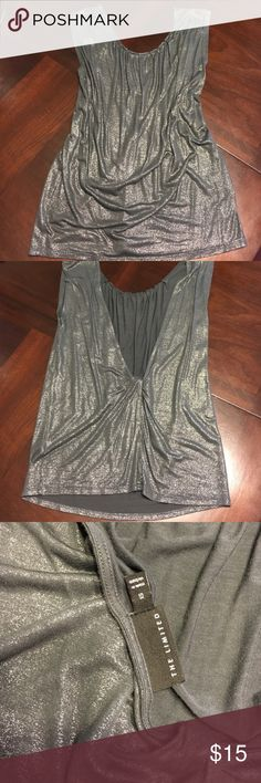 Sparkly Metallic Backless Sleeveless Top Super cute open back top. Silver metallic over grey. Lose fitting would also fit a small. Never worn!!!  🍍 Have questions? Please ask! 💚 I love offers! 🍍 I won't be offended when you lowball only if you won't be offended when I counter.  💚 Please use the offer button or my 'Closet Rules' thread to negotiate bundles. 🍍  Refer to my handy chart for guidance on offers. 💚 Bundle & save! The Limited Tops