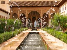 I love the garden space and the fountain leading to the arches.