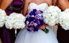 Purple and white wedding! Bride's bouquet: lavender roses, royal violet lisianthus, lilac hydrangea, and white stephanotis with deep amethyst Swarovski crystals. Bridesmaid bouquets: white hydrangea sparkling with the same dark amethyst rhinestones. #plum #eggplant
