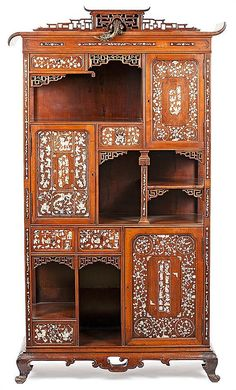 Chinese dresser in carved and fretted tropical wood with etc