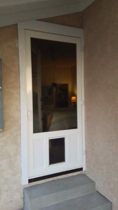 dog door installed in storm door website has good info ideas for