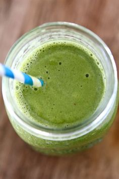 Green smoothie with spinach, orange, banana, and strawberry. Subbing coconut milk for yogurt.