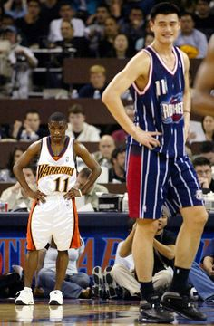 Talk about height difference! Earl Boykins, at 5'5', next to 7'6' Yao Ming!