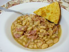 Slow Cooker Ham & White Beans.  I made this more like a soup and it turned out pretty good.  Served it with cornbread.  Rating 7.5