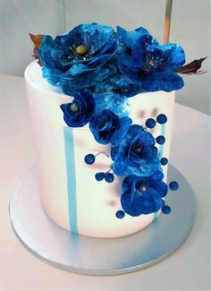Blue box cake with wafer paper flowers  by Clara - http://cakesdecor.com/cakes/260798-blue-box-cake-with-wafer-paper-flowers