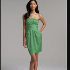 Short strapless cotton sateen dress Clover green David's bridal short sateen dress size 2. Worn once with no alterations. I actually wore it to a bridal tea, so very versatile! Comfortable with pockets! Will steam iron before shipping! David's Bridal Dresses Strapless